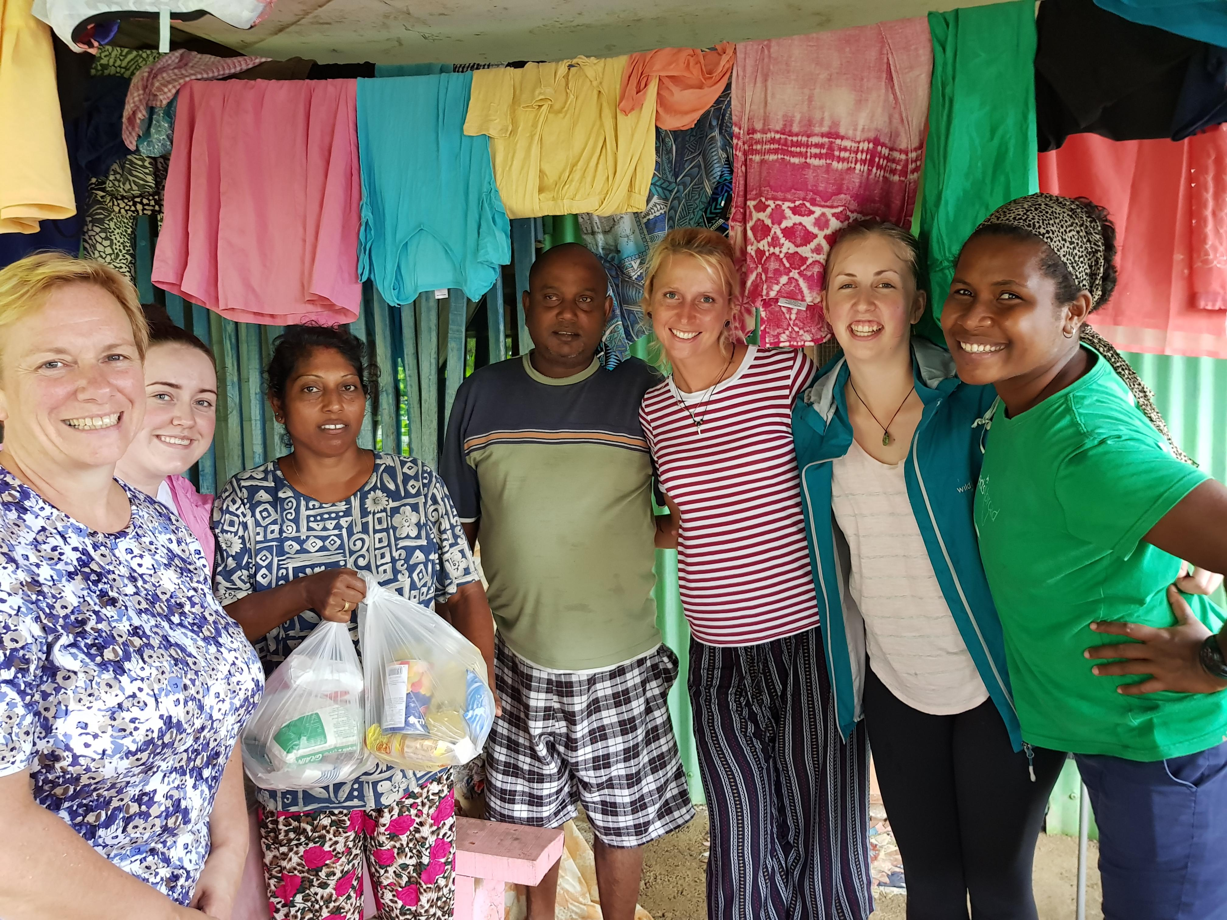Female Community Volunteers pose with a local couple at a Community Day during Cultural Immersion in Fiji.
